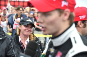 Car owner Sarah Fisher looks on as race winner and CFH driver Josef Newgarden is being interviews - Photo by Chris Jones for IndyCar