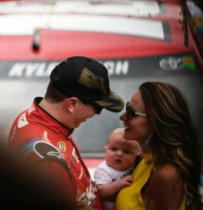 Kyle Busch celebrates with his wife Samantha and son Brexton after winning the Brickyard 400 -- Image by Chris Cross for the Indianapolis Motor Speedway