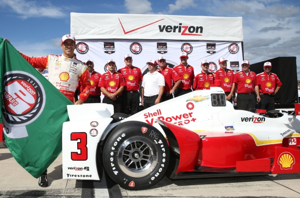 Helio Castroneves celebrates his Verizon P1 Award for winning the pole position in the ABC Supply 500 at Pocono Raceway -- Photo by Chris Jones
