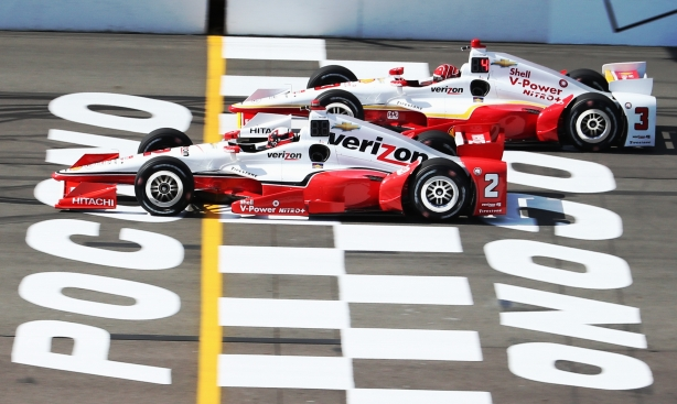 Team Penske teammates Juan Pablo Montoya and Helio Castroneves cross the start finish line during practice for the ABC Supply 500 at Pocono Raceway -- Photo by Chris Jones
