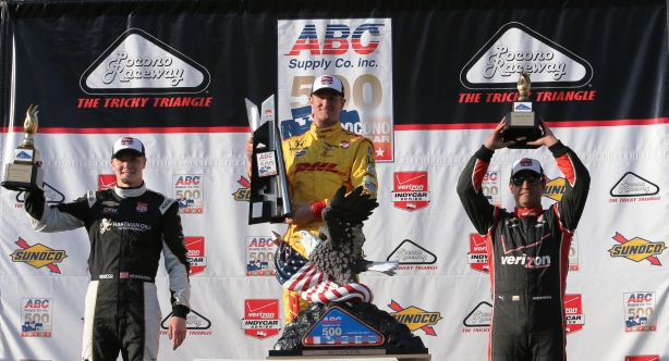 The podium of Ryan Hunter-Reay, Josef Newgarden, and Juan Pablo Montoya hoist their trophies in Victory Lane following the ABC Supply 500 at Pocono Raceway -- Photo by Chris Jones