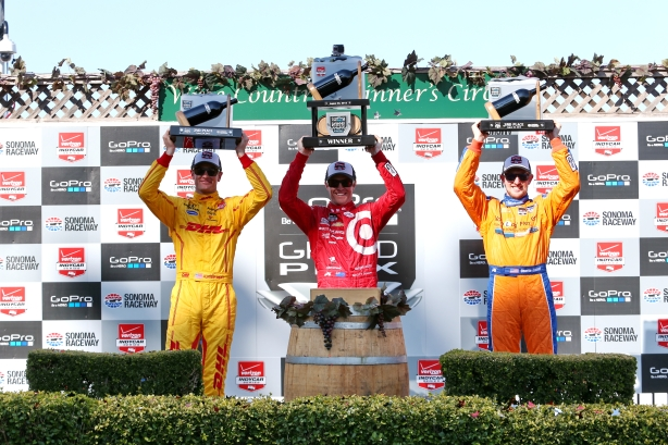 The podium of Scott Dixon, Ryan Hunter-Reay, and Charlie Kimball hoist their trophies in Victory Circle following the GoPro Grand Prix of Sonoma -- Image by Chris Jones