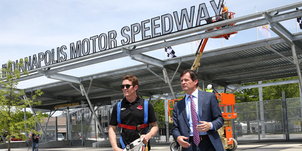 Verizon IndyCar Series driver Scott Dixon speaks with IMS President Doug Boles after help install the final touches to the new Gate 1 at IMS -- Photo by: Chris Jones