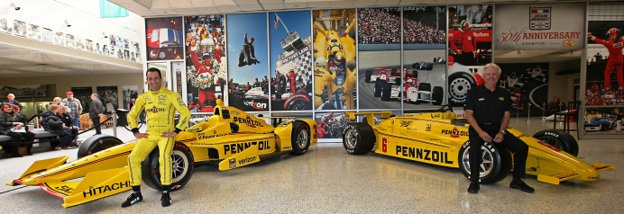 Three-time Indianapolis 500 winner Helio Castroneves stands alongside four-time Indianapolis 500 winner Rick Mears -- Image by Joe Skibinski