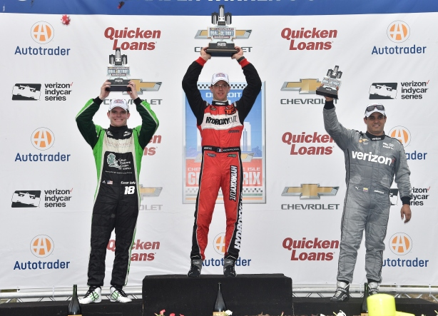 Sebastien Bourdais, Conor Daly, and Juan Pablo Montoya hoist their trophies on the Winner's Circle at Belle Isle Park following Race 1 of the Chevrolet Dual in Detroit -- Image by: Chris Owens