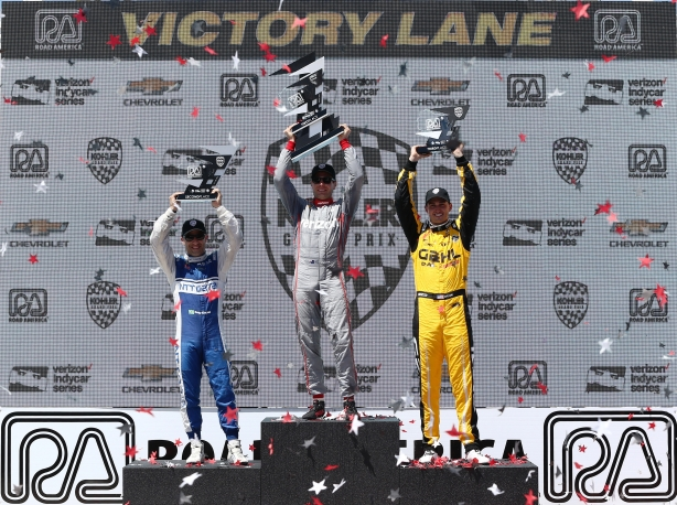 Will Power, Tony Kanaan, and Graham Rahal hoist their trophies in Victory Lane following the KOHLER Grand Prix of Road America - Image by Chris Jones