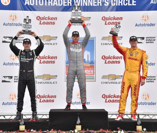 Will Power, Simon Pagenaud, and Ryan Hunter-Reay hoist their trophies on the podium following Race 2 of the Chevrolet Dual in Detroit at Belle Isle Park -- Image by Chris Owens