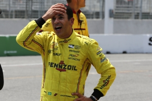 Helio Castroneves reacts after being nipped for the pole position for the Honda Indy Toronto -- Image by Chris Jones