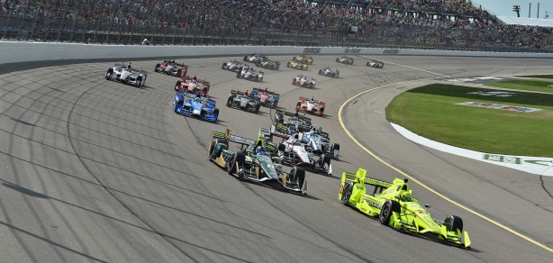 Simon Pagenaud and Josef Newgarden lead the field into Turn 1 during the Iowa Corn 300 at Iowa Speedway -- Image by Chris Owens