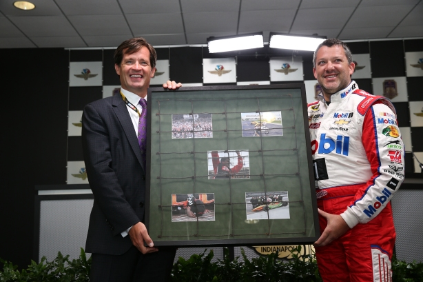 Tony Stewart receives a piece of old track fence from IMS President Doug Boles during a press conference at IMS -- Photo by Bret Kelley