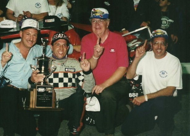 The lone NASCAR Modified Tour championship won by car owner Mario Fiore, right, and his famed No. 44 team came in 2000 with Jerry Marquis, second from left, behind the wheel and sponsorship from Ted Hebert, left, of Teddy Bear Pools. Fiore died n June at the age of 65.