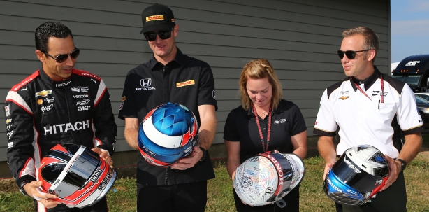Helio Castroneves, Ryan Hunter-Reay, Sarah Fisher, and Ed Carpenter receive their recovered helmets that were previously stolen from INDYCAR. -- Image by Chris Jones