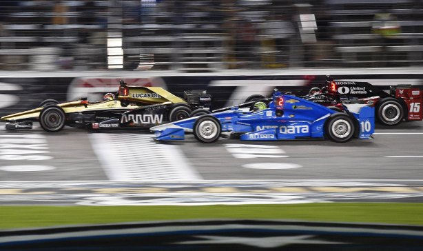James Hinchcliffe leads Tony Kanaan and Graham Rahal across the start-finish line during the Firestone 600 at Texas Motor Speedway -- IndyCar Image by Chris Owens