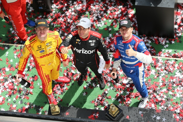 The podium of Will Power, Mikhail Aleshin, and Ryan Hunter-Reay celebrate in Victory Circle following the ABC Supply 500 at Pocono Raceway -- IndyCar Image by Chris Jones