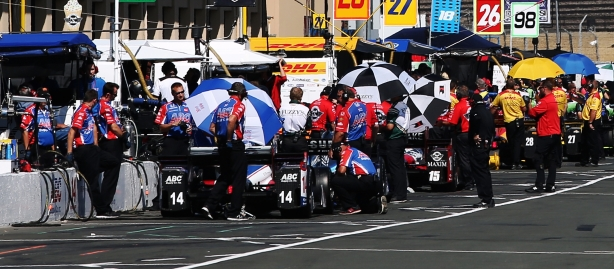Pit lane comes to life prior to practice for the GoPro Grand Prix of Sonoma -- Image by Chris Jones