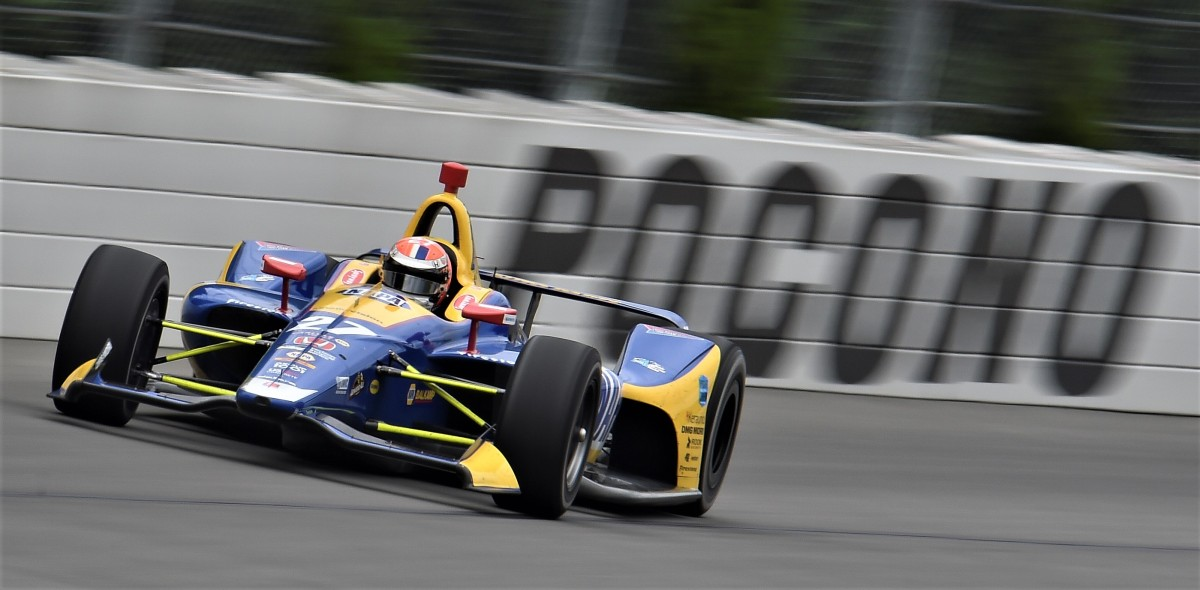 Rossi keeps pressure on in championship with dominant victory at Pocono ...